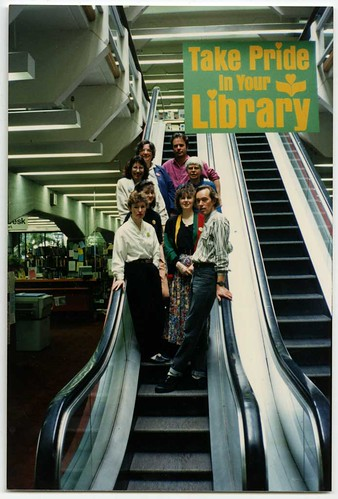 Staff group on escalator, Central Library