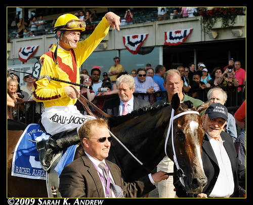 Rachel Alexandra and her connections head to the winner's circle after winning the Grade 1 Mother Goose