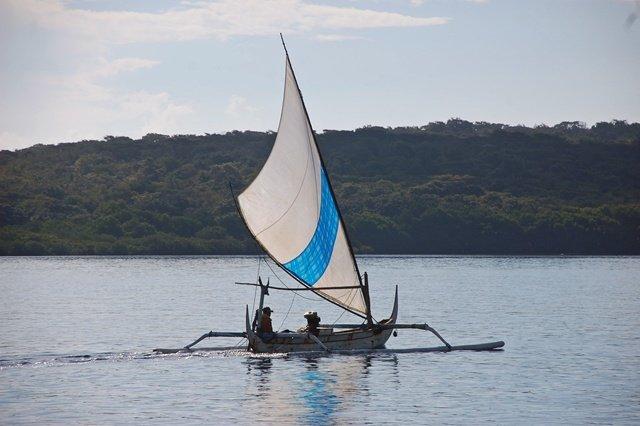 Indonesia outrigger sailing canoe bali fisherman