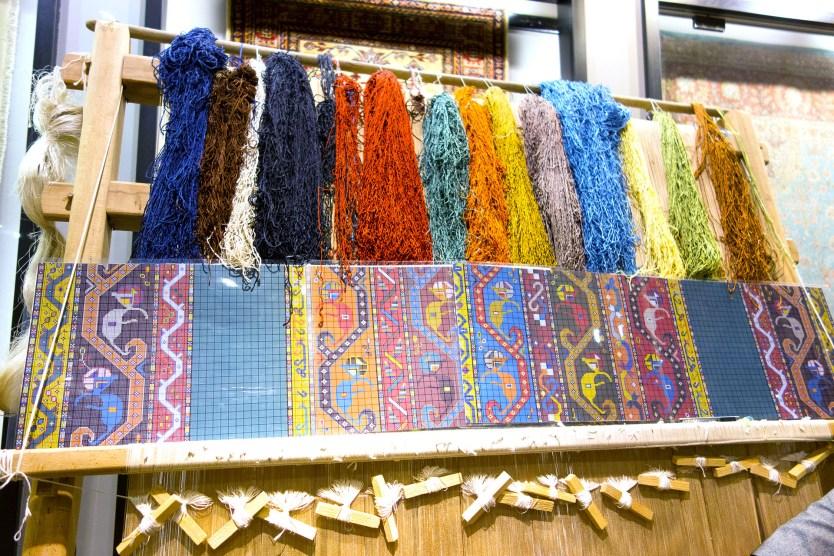 Hand weaving a Turkish Rug.