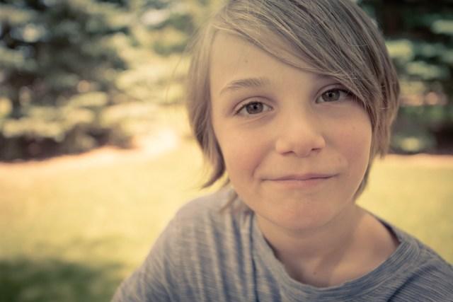 25/52/Portrait - Big Kid, Half Smile, Fully Content.