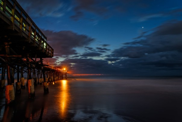Venus rising past the pier