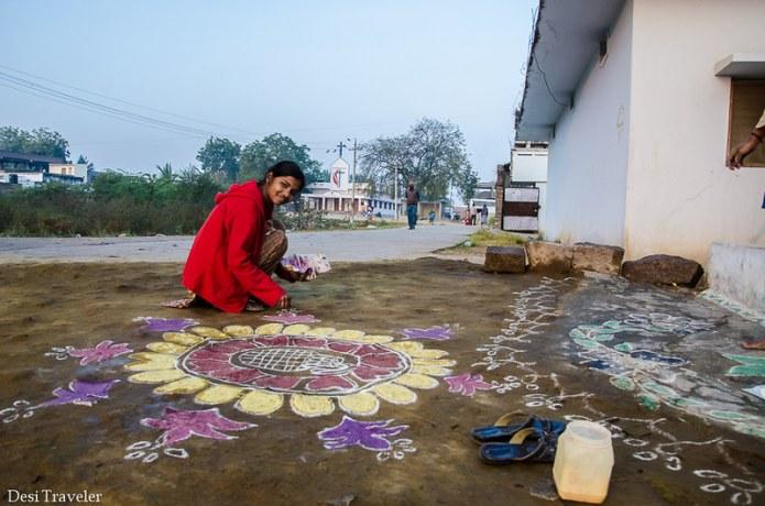 girl making rangoli in Telangana Village India