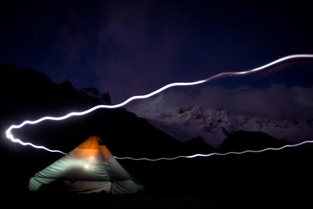 Dark falls over Tocllaraju (6032m) and Ishinca (5530m) basecamp. Cordillera Blanca. Peru.