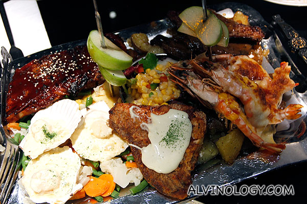 Items include Roasted beef with black pepper sauce, Premium BBQ baby back ribs, Pan Seared snapper with wasabi mayo sauce, Oven Baked King Prawns with melted Australian cheese, Sauteed scallop with garlic & wine sauce