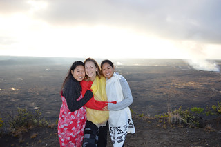 Nina, Alexa, Jules wearing Kihei, offering Ho'okupu at Halema'uma'u crater
