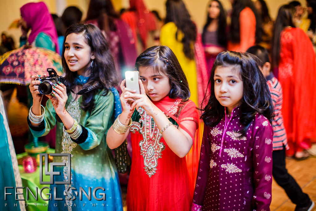 Young guests in Indian sarees take photos