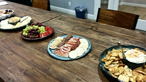 fruits, charcuterie, and pita and hummus platters by pipsyq