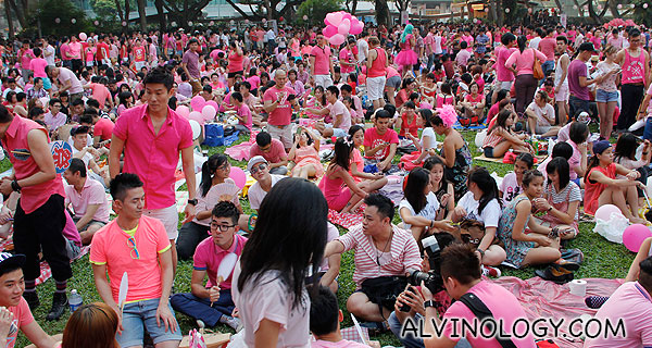 Crowd having picnic on the grass patch