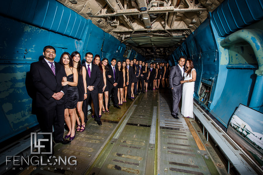 Indian wedding group photo inside an airplane