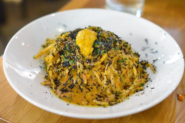 Spaghetti Rustichella. sea urchin. squid ink bottarga. garlic. calabrian chiles. breadcrumbs.