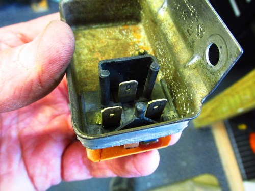 Bottom of Voltage Regulator Housing Showing Where Plug Fits