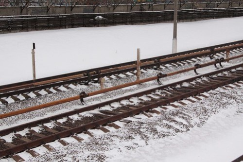 Third rail running down the middle of the two tracks