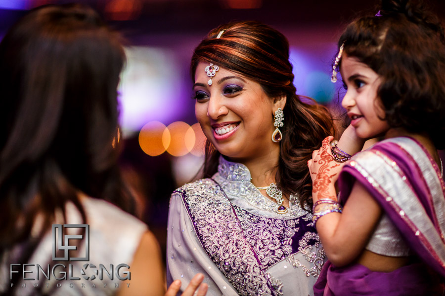 Kanwal and Ali greet guests at their tables during the wedding reception