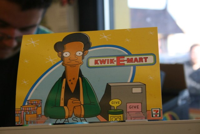 Apu at the register at The Simpsons 7-Eleven Kwik-E-Mart in Chicago, Illinois