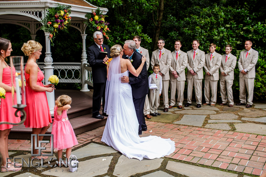 Father kisses his daughter the bride goodbye