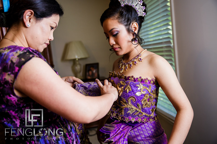 Cambodian bride dressing in traditional wedding dress
