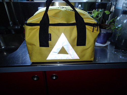 reflective triangle on the bag will face toward traffic behind me, hopefully getting drivers attention during winter, night and rainy commuting