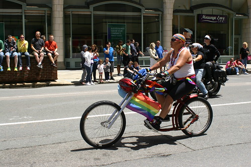 """Dyke"" on rainbow pedal bike"