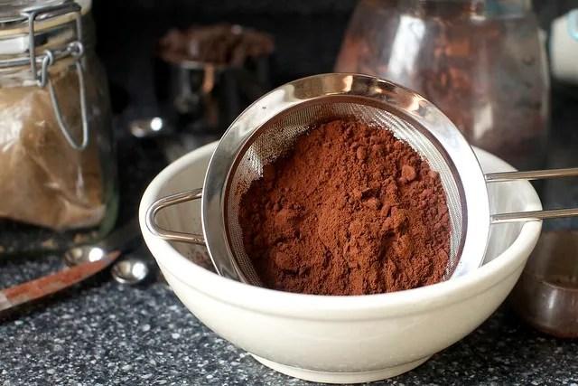 sifting dark cocoa powder