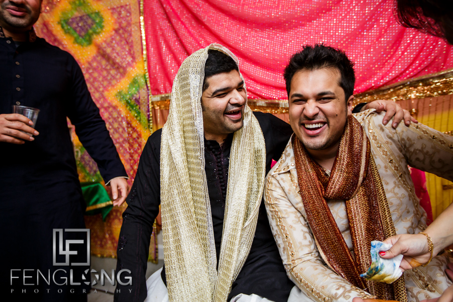 Groom and friends laughing during mehdni night