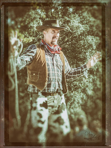 Image of cowboy on stilts post-processed using Nik Analog Efex Pro