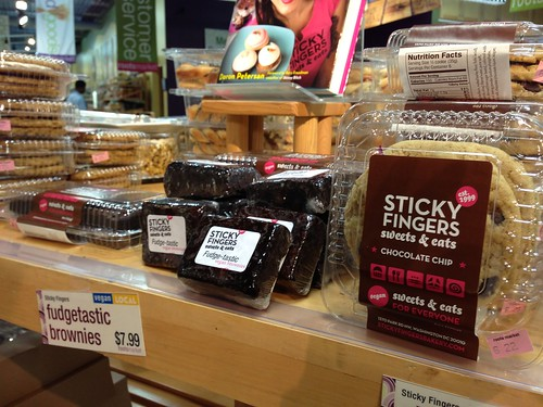 A shelf stocked with Sticky Fingers brownies and cookies.