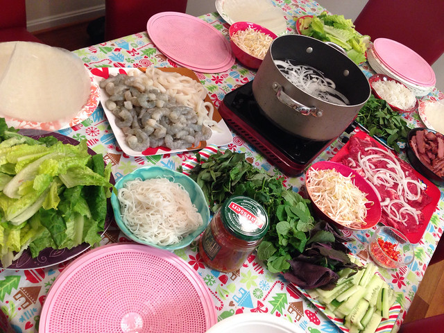 Ingredients for hot pot rice paper rolls including shrimp, calamari, beef, grilled pork, and vegetables