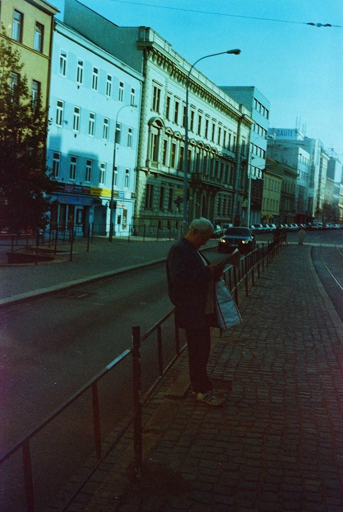 Smena 8M - Man Reading at Tram Stop