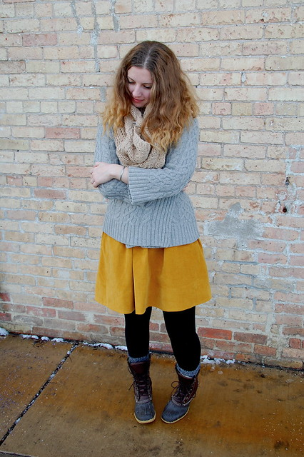cabled cardigan/yellow skirt