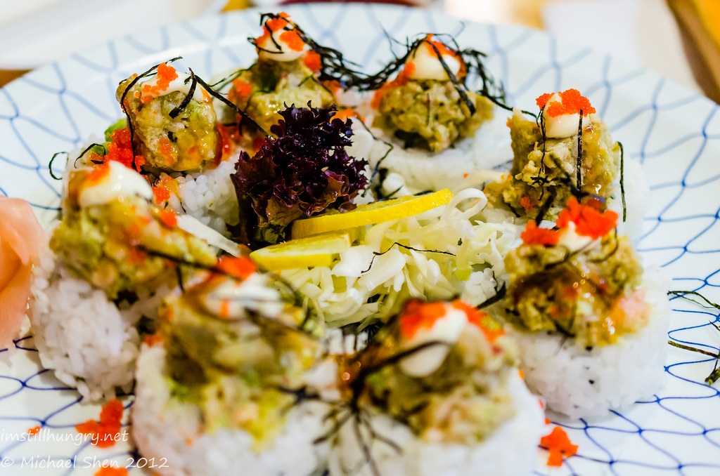 Kansai Volcano Roll - crabmeat, cucumber and avocado filling topped with baked salmon, masago, spicy sauce and mayonnaise