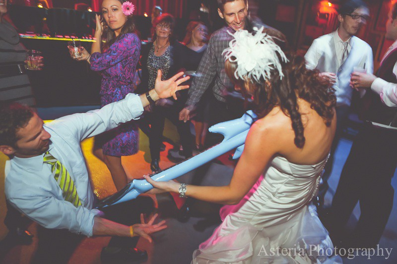 Bride and guests rocking out during reception