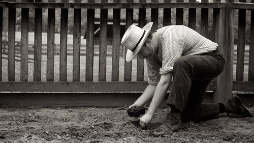 A farmer planting vegetables