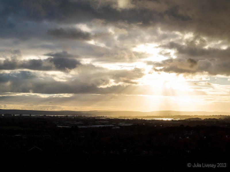 The suns rays break through the clouds over Poole