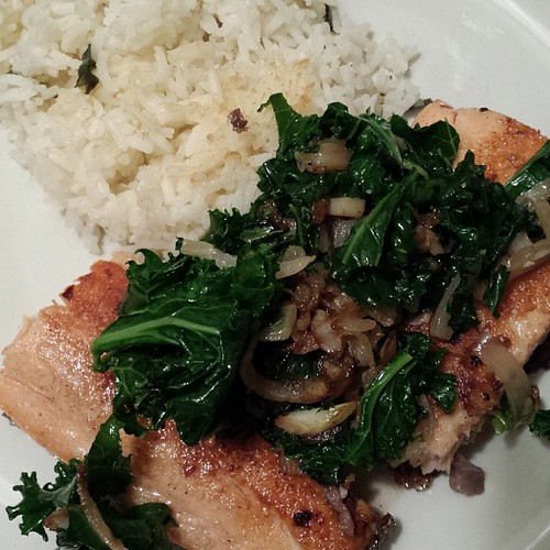Pan-fried Salmon with Onions,  Garlic, and Kale accompanied bu Cilantro-Jasmine Rice, and Sweet Wine. #foodie #ieatthereforeiam #nofilter by Jennifer O'Connell