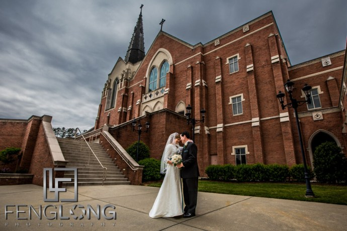 Bride and groom pose in front of the church after the wedding ceremony