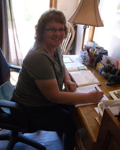 Mom finishing paperwork