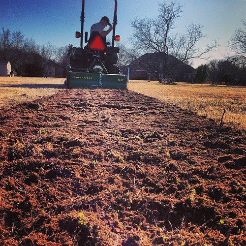 He's tilling up a garden! #rishergarden2014 #newtractortoy