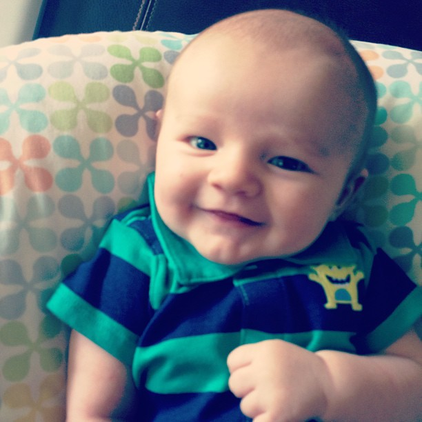 After a fussy night, E is back to his smiley self. Smiling > Shots