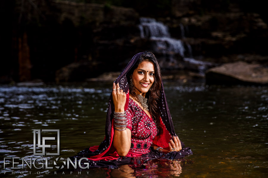 Indian bride in the water in romantic pose