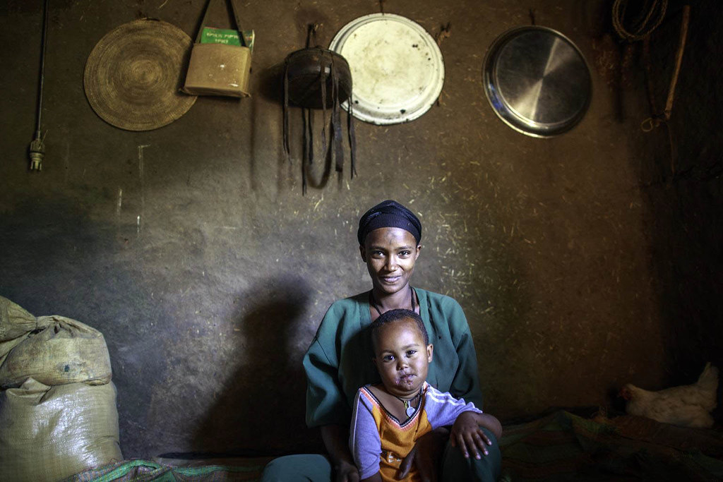 Haimanot Andarge, 20, and her daughter Azeb Abraru, 23 month, relax at home in Dera Woreda in Amhara region of Ethiopia