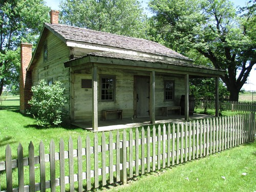 Each house in the Buxton Settlement had to be built at least 24x18x12 feet with a front porch, picket fence and flower garden.