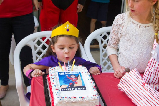 blowing out her candles