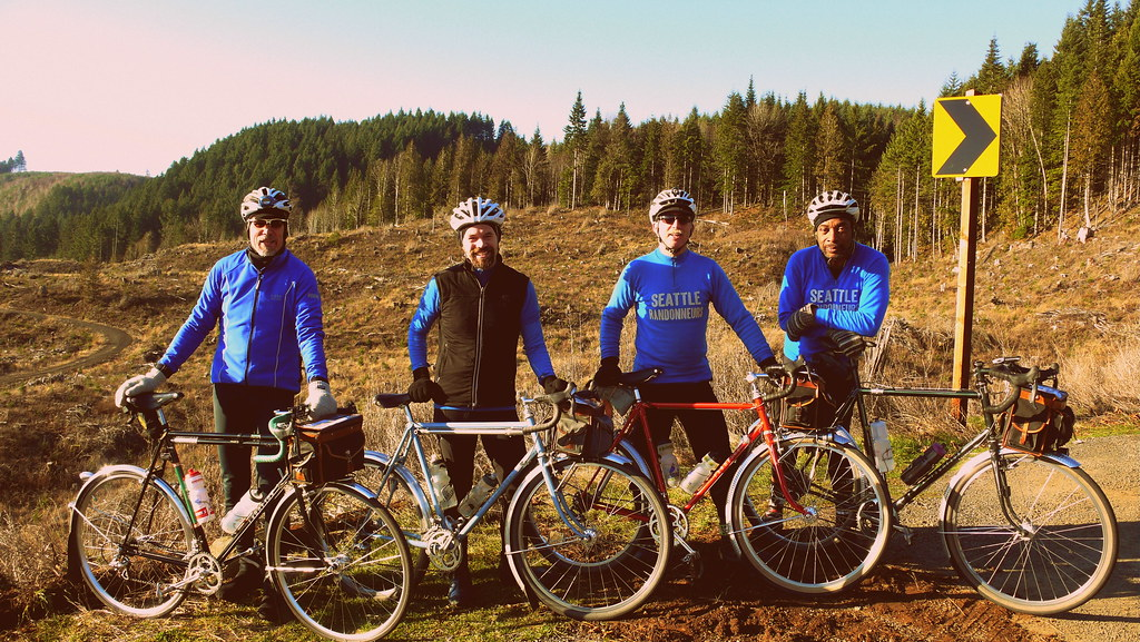 Four Randonneurs with Thompson Custom Bicycles in Oregon on a sunny permanent route of 200K