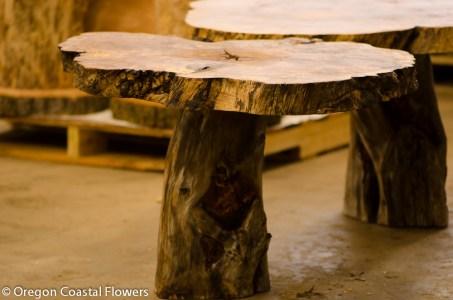 Character natural wood pedestal tables