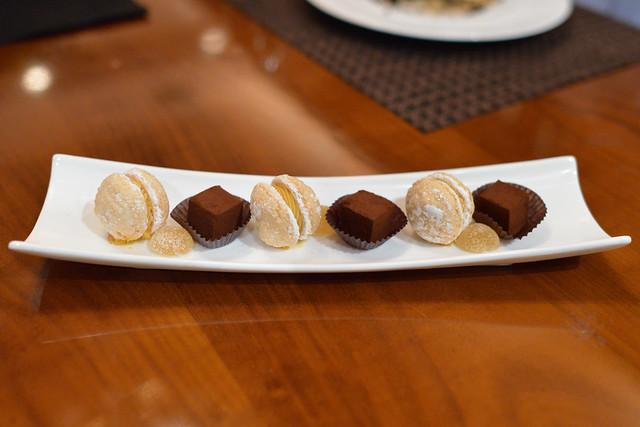 Mignardises almond-hazelnuts macaron, chocolate ganache, pear pate de fruits