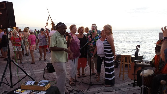 This is my mother-in-law singing with Jamaican buskers in Mallory Square.