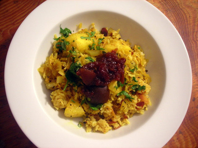 Pineapple curry, over lemon and almond rice, with spiced lime pickle
