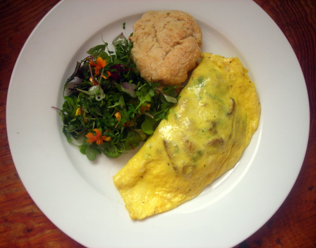 Chanterelle mushroom omelette, micro greens and marigold salad, buttermilk biscuit
