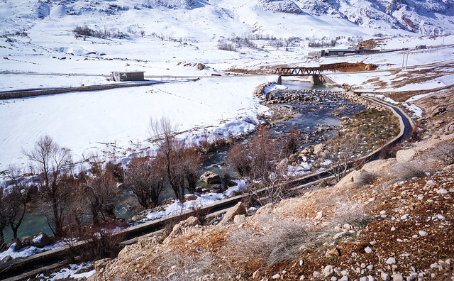 Snow-flanked mountains feed the river